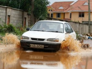 A motorist drives through the flooded Fairways Road in South C, Nairobi, on April 5. Nairobi residents grappled with fl ooded streets and blocked roads as heavy rains pounded the city and its environs for more than three months, following a long dry period /JACK OWUOR